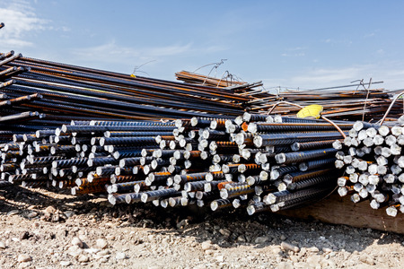 Steel bars stacked for construction, classified by the bending shape at construction site.