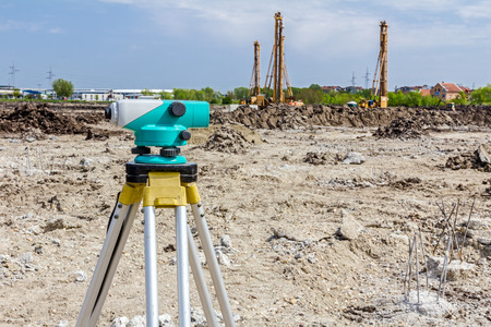 tacheometer: Surveyor engineers equipment for measuring level on construction site. Surveyors ensure precise measurements before undertaking large construction projects.