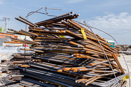 reinforcement: Steel bars stacked for construction, classified by the bending shape at construction site.