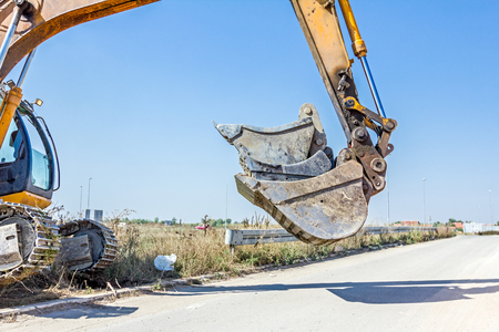 Excavator buckets are vertically arranged, various types, sorted by size, transported.