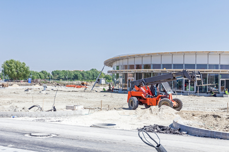 Telescopic forklift is parked on a construction site after job is done.