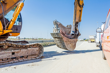 manage transportation: Excavator buckets are vertically arranged, various types, sorted by size, transported.