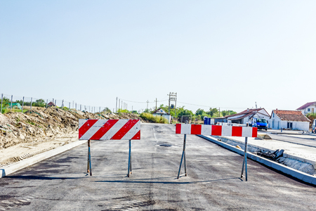 Closed enter at construction zone, work in progress, sign with boundary are symbols of caution, road resurfacing signal. Stock Photo
