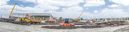 manage transportation: Panorama is showing a landscape transform into urban area with machinery, people are working. View on construction site. Stock Photo