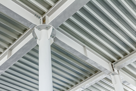 joist: View from below on new ceiling; pillars with steel joints are painted in white.