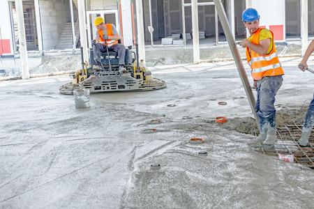self operation: Zrenjanin, Vojvodina, Serbia - July 28, 2015: Self leveling power trowel machine, sander, for smoothing surface to finish concrete slab.