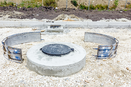 orifice: New manhole with disassembled demountable the metal mold. Stock Photo