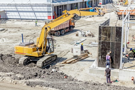 folding arms: View on building site until workers are assembly a huge mold for concreting.