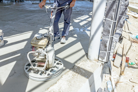 self operation: Self leveling power trowel machine, sander, for smoothing surface to finish concrete slab.