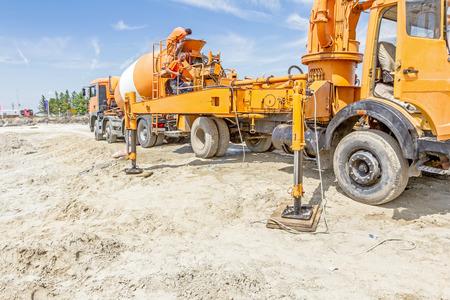 Zrenjanin, Vojvodina, Serbia - July 28, 2015: Truck mixer is pouring concrete into concrete pump for casting.