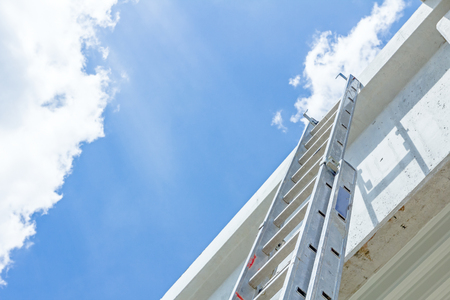 Architecture concept, concrete structure girders, ladder to the sky reaching for the higher place Stock Photo