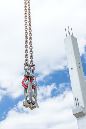 View on additional catchers on crane hooks for carry concrete beams. Stock Photo