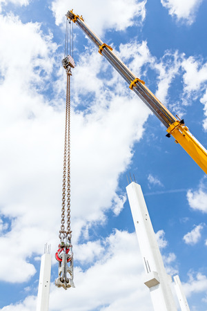 special steel: View on additional catchers on crane hooks for carry concrete beams. Stock Photo