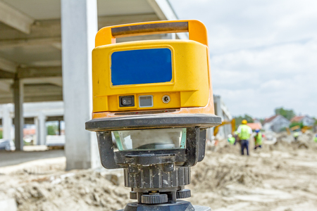 Red laser is leveling device central device to level construction site.