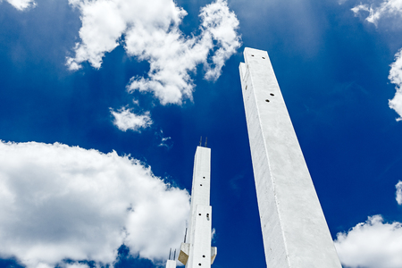 Architecture concept, concrete skeleton against blue cloudy sky Stock Photo