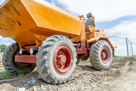 Little construction dumper carrier is at building site. Stock Photo