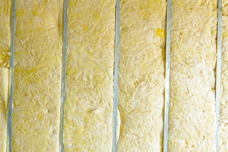 Galvanized steel joist is holding thermal insulation material, rock wool. Stock Photo