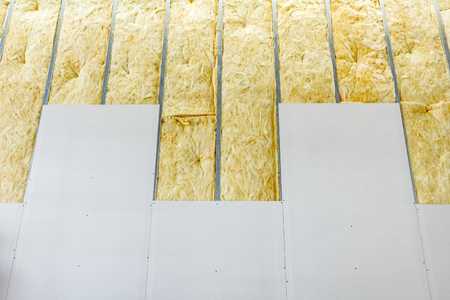 View at unfinished thermal partition dry wall with mineral wool. Stock Photo - 73420826
