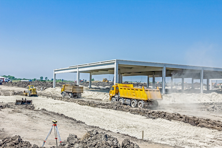 manage transportation: Big hydraulic dump truck is in transport on building site. Stock Photo