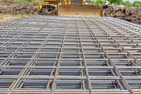 reinforcement: View on perspective over square reinforcement for concrete. Stock Photo