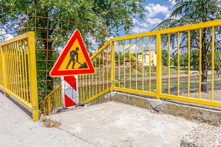 closed community: Closed enter at construction zone, work in progress, sign with boundary are symbols of caution, road resurfacing signal. Stock Photo
