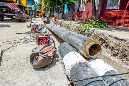 Necessary tools, equipment for welding pipeline lined next to the trench. Stock Photo