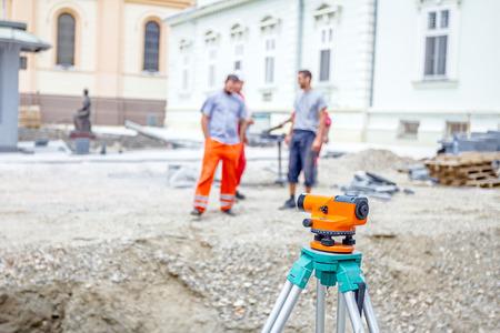 Surveyors ensure precise measurements before undertaking large construction projects.