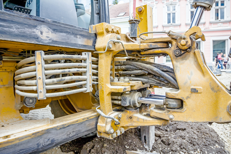 View on hydraulic pressure system with hoses for excavator arm. Stock Photo
