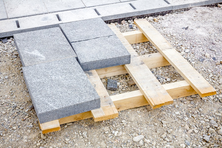 Above view on wooden pallet with paving slabs at building site ready for use. Stock Photo