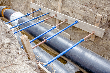struts: Trench walls are reinforced with supports to prevent sloughing of the soil.
