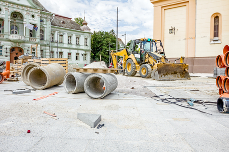 Concrete prefabricated pipes for manhole or drainage stacked at building site.