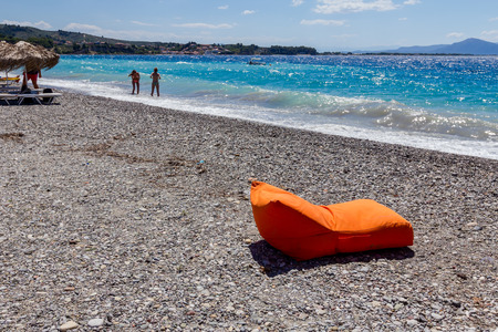 luxurious: Luxury and comfortable mattress sunbed is placed on the sunny beach.
