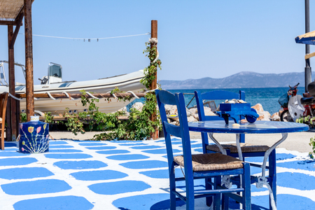 sunshade: Abstract scene with colored floor as decoration detail at traditional Greek tavern restaurant.