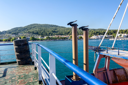 View of the fishing ship or ferry boat deck with exhaust pipe with metal cover.