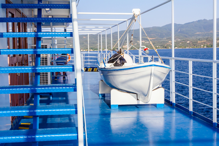 Lifeboat on a ships deck, ferryboat with mechanism for emergency disembarkation. Stock Photo