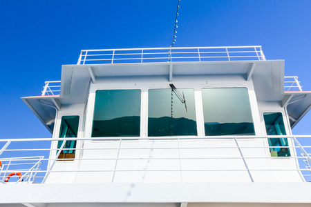 Outdoor view on captains cabin, control room with reflection on windows. Stock Photo