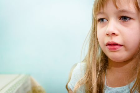 Little girl has catch a cold, she is cough at home. Stock Photo
