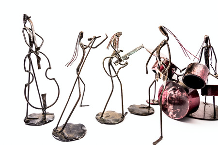 Figures of music performers made with welded black metal wire. Band made of: guitarist, contrabass, drummer and singer are playing together. Living lines