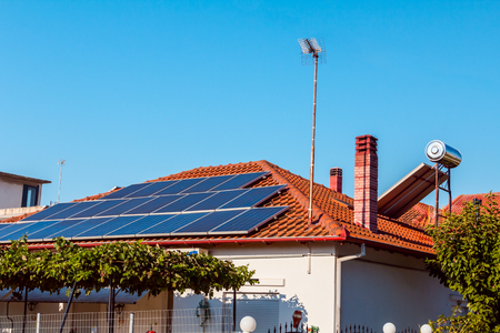 Solar cell panels are using renewable sun energy for making electricity, placed on house roof. Modern energy saving technology Stockfoto - 113797162