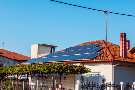 Solar cell panels are using renewable sun energy for making electricity, placed on house roof. Modern energy saving technology