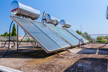 Water panels for using renewable sun energy are placed on house roof, solar hot water system. Modern energy saving technology Stockfoto