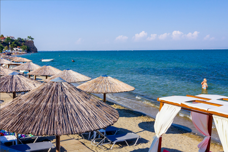 Above view on sunshades, umbrellas, deckchairs and luxury comfortable wooden pergola are placed at public beach for a perfect holiday. 版權商用圖片