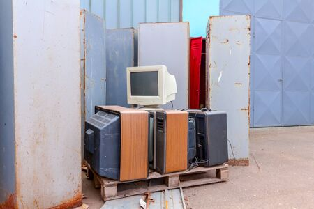 Piled up several retro, old vintage TV and one PC display, they are ready for recycling. Imagens