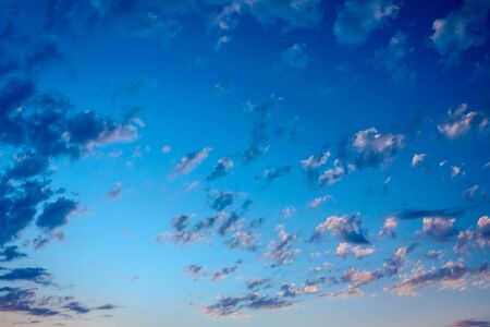 Scenic view is on beautiful blue sky with white fluffy clouds.