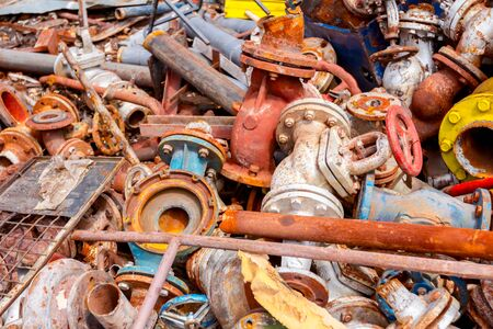 Different shapes and sizes of cut old valves and equipment, industrial scrap metal, after cassation for recycling metal. 写真素材