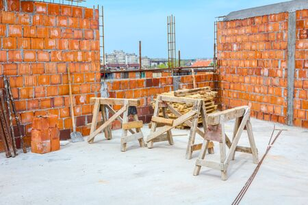 Wooden frame truss made of beams for mobile scaffold at building site, under construction.