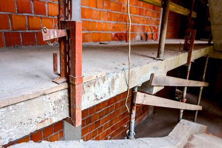 Clamp of improvised safety stairway fence in building under construction.