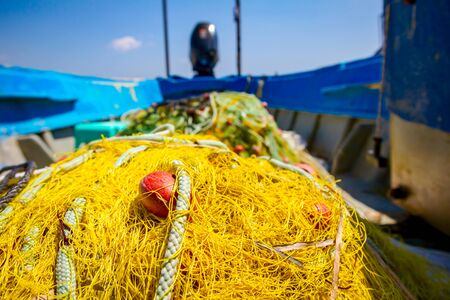 Pile of commercial fishing net, equipment for angling at open sea. Stock fotó