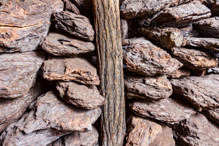 Storage of dry wooden coal, charcoal is piled and ready for ussage. Stock Photo
