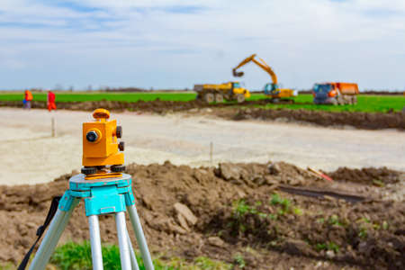 Surveyor instrument is for measuring level on construction site. Surveyors ensure precise measurements before undertaking large construction projects. Stock fotó